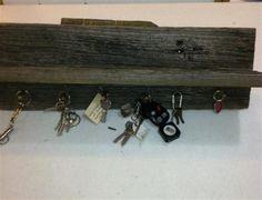 Barnwood Shelf and key holder. Handmade with 200 year old barnwood.  Barnwood pegs hold the keys