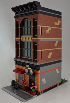 I wanted the bike shop to be in a more industrial looking building, so neither of my buildings inspired by the official Bike Shop set fit the bill. The ground floor has helmets, skateboards, and a little repair area, while the top two floors have bicycles, motor bikes and scooters.  Front perspective.