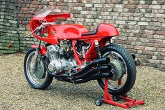 Benelli Sei cafe racer  Looks like a CB750 SOHC with 2 extra cylinders. Predecessor to the CBX?