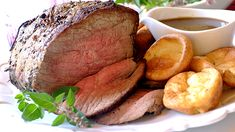 ROAST BEEF AND YORKSHIRE PUDDINGS - Roast beef, Yorkshire pudding, and all the trimmings served with lashings of gravy – the perfect Sunday lunch!