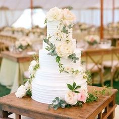 a simple wedding cake decorated by the talented Mindy Rice made by with Zephyr Tents La Tavola Linen Katie Colosi Julie Song photo by Aaron Delesie wedding cakes cakes elegant cakes rustic cakes simple cakes unique cakes with flowers Wedding Cake Decorations, Wedding Cakes With Flowers, Beautiful Wedding Cakes, Wedding Cake Designs, Beautiful Cakes, Flowers On Cake, 4 Tier Wedding Cake, Beautiful Things, Classic Wedding Cakes