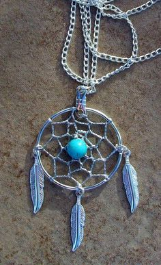 I bet I could make this! Idk who'd wear it though.....dream catcher necklace(: