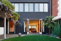 Unique Home Renovation in Contemporary Design and Artworks Combination: Unusual Horizontal Siding In Black Combined With Red Brick Walling And Decorated With Plenty Of White Trims ~ SQUAR ESTATE Architecture Inspiration