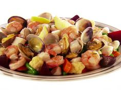 Giada includes a traditional Holiday Seafood Salad on her Christmas menu. Watch on ulive