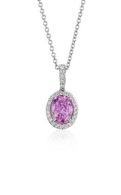 This pretty pink sapphire and diamond halo pendant is the perfect spring accessory!