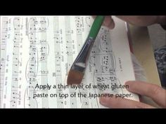 Repairing a page tear using Japanese paper