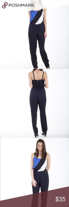 """v i n t a g e 80s black jumpsuit Vintage 80s black jumpsuit with blue & white accent color. Spaghetti strap top, elastic waist & back, & attached belt loops.   •true vintage  •nylon polyester blend  •excellent condition   measurements  •vintage size 7  •bust 32""""+ •waist 24""""-28"""" •inseam 28"""" •rise 13""""   All orders ship with 1-2 business days. No trades or holds. All photos  are original and of the exact item being sold. Vintage Pants Jumpsuits & Rompers"""