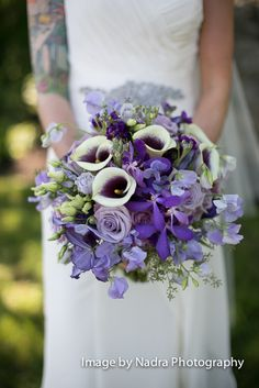 purple wedding flowers, adding some yellow would be cute!