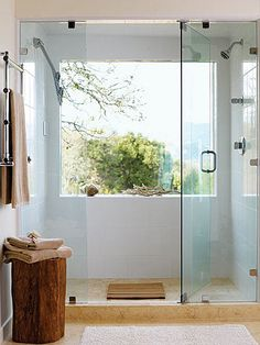 We love this giant window in the #shower. The view is great for a morning shower in this #bathroom. www.remodelworks.com