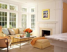 A yellow couch works when everything else is white, I see.   The kitchen opens to a sunny family room in this Connecticut home by residential designer Louise Brooks, allowing family and friends to converse with people working in the kitchen.