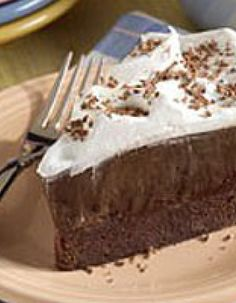 "Brownie Bottom Pudding Pie — A fudgy baked brownie ""crust"" is topped with creamy chocolate pudding and whipped topping for a decadent chocolate lovers' pie."