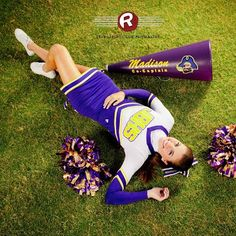 Birds eye angle senior portrait of a cheerleader with pom poms & megaphone by Ryan David Jackson Photography located in Fayetteville, NC. www.seniorportraits.ryandavidjackson.com  #outdoorportraits #ncportraits #northcarolina #photography #photographer #ncseniorportraits #bestphotographer #fayettevillephotography