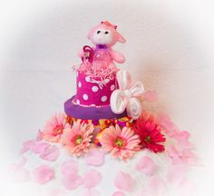 Little Lambs Diaper cake made with Burp cloths, Receiving blankets, Baby Washcloths and baby essentials, Binky and Bottle