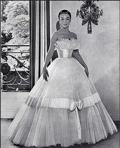 1957French dancer/actress Ludmilla Tchèrina in evening gown by Carven, photo by Guy Arsac