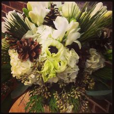 White hydrangea, pine cones, freesia, and anenome: Bridal bouquet by Trish Upshaw