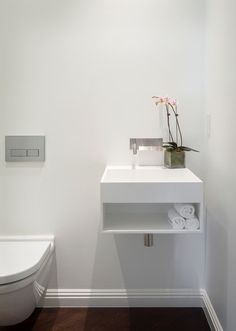 Modern Bathroom Sinks Powder Room Contemporary with Baseboards Dark Floor Floating1