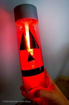 How to make a pumpkin Sensory Bottle {Jack-o-lantern for halloween} - Kid Activities with Alexa Sensory Bottles For Toddlers, Sensory Bottles Preschool, Glitter Sensory Bottles, Sensory Bins, Motor Skills Activities, Kid Activities, Fine Motor Skills, Halloween Activities For Kids, Halloween Kids