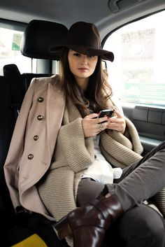 Oh don't mind me and my super stunner outfit. I'm just texting while sitting in a cab looking glamorous. haha i do like this outfit though. it reminds me of something from the UK.