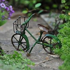 Green Bike | Teelies Fairy Garden Store Give your fairies happy and playful moments by getting this antique and adorable green bicycle. #teeliesfairygarden