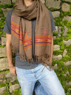 Diamond weave in a warm Cappuccino brown wool on a brown wool base, handloomed to perfection using traditional methods,with a vibrant cashmilon tribal pattern.Large in size and can be used as a light blanket, neck scarf , shawl or wear it the way you want.