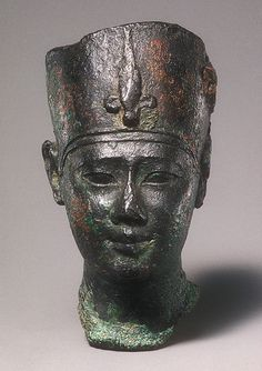 Head of Ptolemy II or III Period: Ptolemaic Period Reign: reign of Ptolemy III Euergetes I Date: 246–222 B.C. Geography: From Egypt Medium: Black bronze Dimensions: Height: 6.5 cm (2 9/16 in.); face h. 2.2 cm. (7/8 in); w. 3.7 cm (1 7/8 in); d. 4.8 cm (1 7/8 in) Credit Line: Purchase, Fletcher Fund and The Guide Foundation Inc. Gift, 1966 Accession Number: 66.99.134