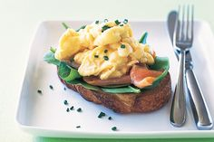 Scrambled eggs with smoked salmon and chives on sourdough main image
