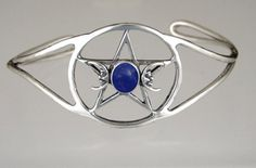 A Stunning Sterling Silver Pentacle with Moons Cuff Bracelet Accented with Genuine Lapis The Silver Dragon- Bracelets. $105.00. This Unique Bracelet is Created only after Your Order Arrives. Please Allow 7-10 days for Delivery.. Designed And Hand- Crafted in Sterling Silver. This Bracelet Fits a Standard Woman's Wrist. This Bracelet was Designed by The Silver Dragon, a Jewelry Shop in New England. Thank you for Supporting American Business.. The Silver Dragon uses Sterling Silv...