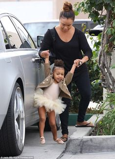 Sweet moves: North showed off her dance moves, stretching out a leg and lifting her arms in the air
