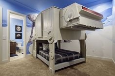 Kids can actually sleep inside this AT-AT Walker, or Imperial Walker, bunk bed in this Star Wars-themed bedroom located in the vacation rental home 7431 Gathering Ct.