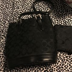 Coach bag and little wallet I'm selling my little black coach bag a mini wallet not entirely sure if it is authentic it was a gift but it looks good to me I'm open to offers and trades if you have any questions just ask:) Coach Bags Mini Bags