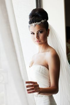 bridal portrait next to window. love the lighting and the angle and her serious graceful look