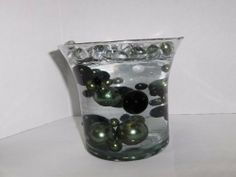Wholesale Unique Elegant Vase Fillers Jumbo to Small Black and Green Pearl Beads -34 Total. The Clear Jelly beadZ Floating the Pearl Beads are included. by weddings and more. $8.95. you get 4 JUMBO, 6 LARGE, 8 MEDIUM, & 16 SMALL a total of 34 Pearls.. We have 7 different colors available. White, Ivory, Pink, Red, Green,Orange & Black. The Oversized pearl Beads are the hottest trend. Great for table accent centerpieces, new gift ideas , weddings and events cente...
