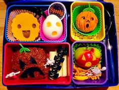 Halloween Pumpkin Patch Bento October 7  I tried these bean burger things that you mix up (it's under the happy yellow face) and made her a hard boiled egg just to try and give her a couple non-snack items to choose from.  The orange pumpkin is yam (she doesn't like yam, trying to sneak it in with a little sugar, a lot of butter and cinnamon), dried corn, half a flax blueberry muffin, cheese, apple and some crackers.