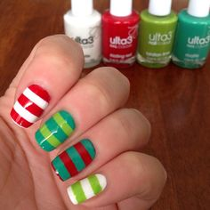 "#NailArtDec - December #22: ""Match socks"" 💚❤️💚 I seriously had no idea what ""match socks"" exactly meant so I attempted (and I use the term loosely) ATTEMPTED stripy Christmassy elf socks. I know y'all can't see that they're actual 'socks' but I like the stripy look of elf socks and actually think this striped pattern 'elf socks' idea is pretty cute 💚❤️💚 #NailChallenge #NailsOfTheDay #NOTD #NailsDid #Nails #ChristmasNails #Stripes #Mani #Manicure #Ulta3 #Elf #Elves #ElfSocks #NailArt"