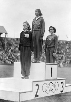 1948 - ALICE COACHMAN - SPORTS - First African-American woman to win an Olympic gold medal. --- Alice Coachman, (C) of the U.S. along with t...