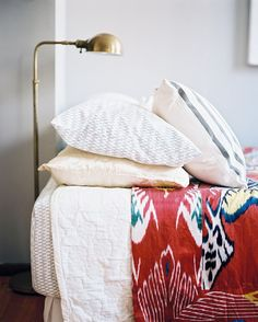 A brass floor lamp beside a bed outfitted with patterned bedding Details: White Bohemian-Vintage Bedroom Keywords: Ikat, August September 2010 Issue, Callie Jenschke, Brass Lamp (Source: Lonny) vintage inspiration Home Design, Design Ideas, Green Bedding, Ikat Bedding, Bedding Sets, White Bedding, Cotton Bedding, White Pillows, Eclectic Bedding