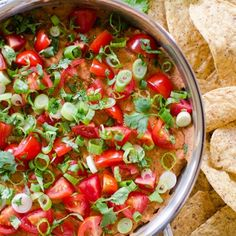 A simple warm dip with the flavors of Mexican seven layer dip, this cheesy refried bean dip will be a crowd favorite.