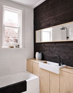 #contemporary #bathroom with #white #subway_tiles, #natural_dark_wood_wall with #light_wood_cabinets