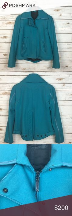 """[Costume National] Teal Wool Moto Jacket Coat Chic Luxury designer wool jacket. Gorgeous real blue color. Style is a cross between a motorcycle jacket and a bomber jacket. Long sleeves. Spread collar. Cool piping details. Zip front with snap closure. Lined. Extremely nice quality. Euro size 40 equivalent to US 8. Check measurements.   🔹Fabric: 80% Wool 20% Nylon Lining is Rayon 🔹Bust: 18"""" 🔹Length: 22"""" 🔹Sleeve Length: 25"""" 🔹Shoulders: 15"""" 🔹Condition: EUC. No flaws.   Measurements taken…"""