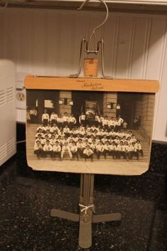 Attaching a vintage pants hanger to a hem marker stand makes a photo display...