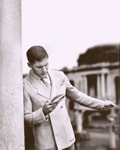 Hardy in a double breasted coat with a wide step lapel.  Looks like the old Rome ruins in the background...
