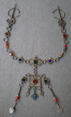 Silver fibula and chain from South Morocco.  Silver, enamel and old millefiori beads    © Ayis, via Ethnic Jewels