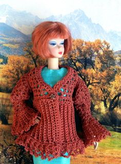 This is my own crochet pattern, Spiced Pumpkin, that I designed for Barbie, Fashion Royalty, and similar sized dolls. It is a cardigan for autumn that incorporates a filet design and a pleated design, with bell sleeves. Skill level = advanced; material used = size 10 crochet cotton. Only the pattern is for sale.    I have this same design available in my shop for a 14 child doll and a 16 fashion doll.    No shipping cost, as you can download the PDF file from Etsy immediately after ...