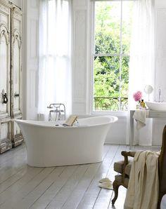 Suzie: Victoria + Albert Baths - Stunning French bathroom with white washed wood floor, ...