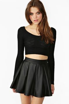 Different crop top, but black one with that skirt.
