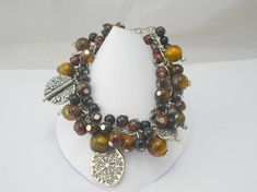 Hey, I found this really awesome Etsy listing at https://www.etsy.com/uk/listing/294076331/tigers-eye-bracelet-beaded-charm