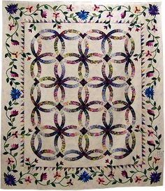 """A Garden For My Wedding -- Judy Neimeyer pattern .... My WIP is this in blues """"just"""" the outer border to go but want a few different flowers"""