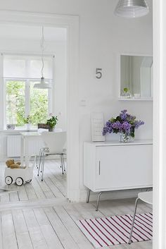 white scandinavian interior with lilacs