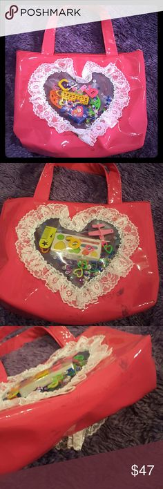 Super cute toy patent bag So cute ! Toy purse Never used it. Had it laying flat w a black purse so there are marks on the top, bottom, and bottom side. Just on the one side. Clean inside. Really dont wanna sell but i havent used it.  Dollskill Toys 90s Vinyl unif  Bags Totes