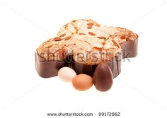 Traditional Italian desserts for Easter - Easter dove with raw eggs and chocolate egg,  isolated on white background. by eZeePics Studio, vi...